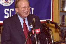 Morgan Wootten, head basketball coach at DeMatha High School smiles at a press conference to announce his stepping down as coach, Wednesday, Nov. 6, 2002, in Hyattsville, Md. Wootten's career record is 1,274-192. (AP Photo/Nick Wass)