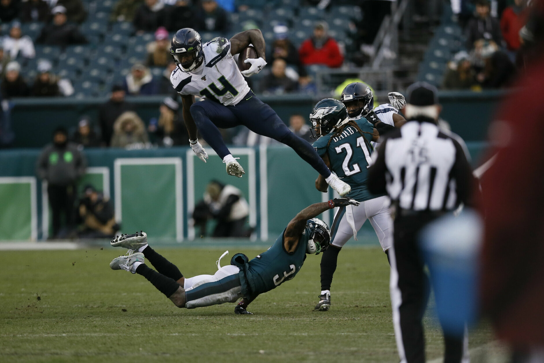 """<p><b><i>Seahawks 17</i></b><br /> <b><i>Eagles 9</i></b></p> <p>Seattle&#8217;s record-tying 11th one-score victory of the season was a tad underwhelming considering it shouldn&#8217;t have been a one-score game against such <a href=""""https://twitter.com/CBSSportsHQ/status/1213995670190858240?s=20"""" target=""""_blank"""" rel=""""noopener"""">an injury-depleted team</a>. But D.K. Metcalf deserves props for setting a rookie record with 160 receiving yards, the fifth-most in NFL history for a player making his postseason debut.</p> <p>Meanwhile, Carson Wentz&#8217;s playoff debut was short lived for the same reason it took him four seasons to make his playoff debut: Injury. <a href=""""https://www.espn.com/nfl/story/_/id/28430769/eagles-call-hit-carson-wentz-dirty-jadeveon-clowney-denies-intent"""" target=""""_blank"""" rel=""""noopener"""">Incidental or not</a>, it was a tough break for the already-shorthanded Eagles, who lost in the Wild Card round for the first time since 2013 despite being <a href=""""https://profootballtalk.nbcsports.com/2020/01/04/eagles-are-underdogs-for-sixth-straight-postseason-game-won-four-of-last-five/"""" target=""""_blank"""" rel=""""noopener"""">a perennial underdog</a>. Josh McCown — who is heretofore &#8220;<a href=""""https://twitter.com/ESPNStatsInfo/status/1213965798873731072?s=20"""" target=""""_blank"""" rel=""""noopener"""">The 40-year-old (Playoff) Virgin</a>&#8221; — filled in admirably, but he&#8217;s clearly no Nick Foles.</p>"""