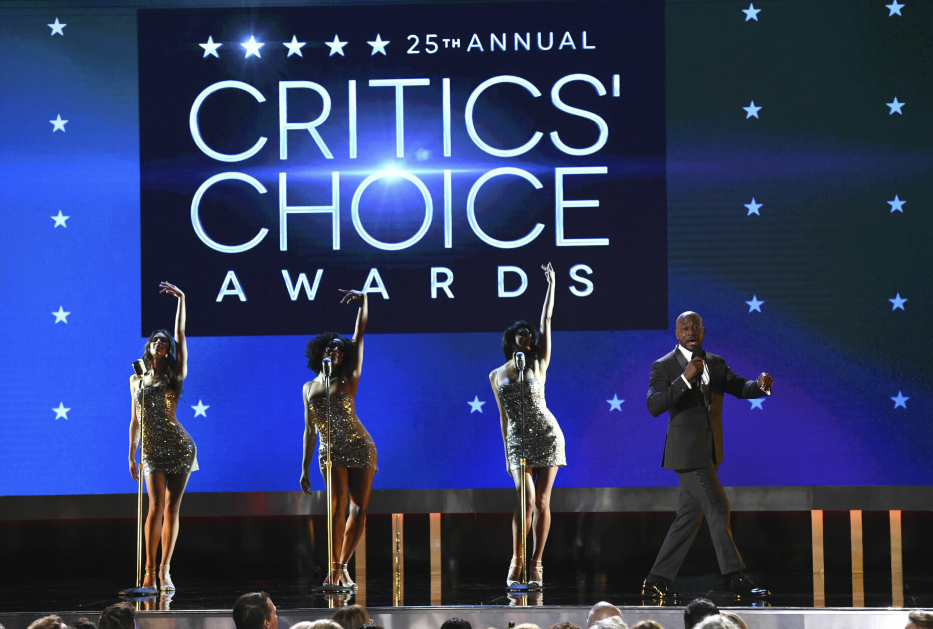 Host Taye Diggs, right, performs at the 25th annual Critics' Choice Awards on Sunday, Jan. 12, 2020, at the Barker Hangar in Santa Monica, Calif. (AP Photo/Chris Pizzello)