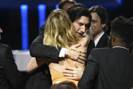 "Adam Driver, right, hugs Laura Dern after she is announced as the award for best supporting actress for ""Marriage Story"" at the 25th annual Critics' Choice Awards on Sunday, Jan. 12, 2020, at the Barker Hangar in Santa Monica, Calif. (AP Photo/Chris Pizzello)"