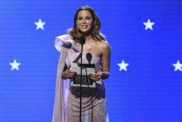 Kate Beckinsale presents the award for best action movie at the 25th annual Critics' Choice Awards on Sunday, Jan. 12, 2020, at the Barker Hangar in Santa Monica, Calif. (AP Photo/Chris Pizzello)