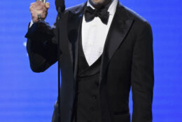 "Jeremy Strong accepts the award for best actor in a drama series for ""Succession"" at the 25th annual Critics' Choice Awards on Sunday, Jan. 12, 2020, at the Barker Hangar in Santa Monica, Calif. (AP Photo/Chris Pizzello)"