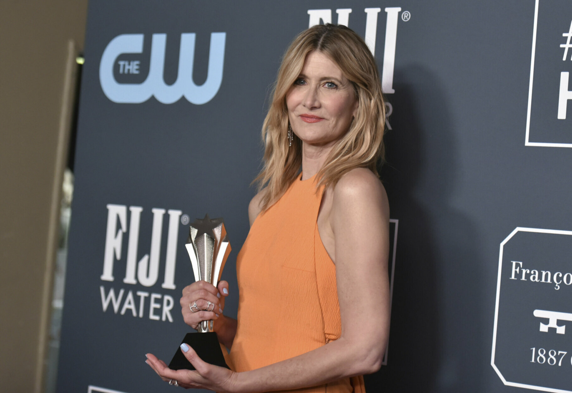 "Laura Dern, winner of the award for best supporting actress for ""Marriage Story"" poses in the press room at the 25th annual Critics' Choice Awards on Sunday, Jan. 12, 2020, at the Barker Hangar in Santa Monica, Calif. (Richard Shotwell/Invision/AP)"