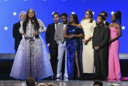 "Ava DuVernay, second left, and the cast and crew of ""When They See Us,"" accept the award for best limited series at the 25th annual Critics' Choice Awards on Sunday, Jan. 12, 2020, at the Barker Hangar in Santa Monica, Calif. (AP Photo/Chris Pizzello)"