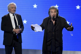 "Robert De Niro, left, and Al Pacino accept the best acting ensemble award for ""The Irishman"" at the 25th annual Critics' Choice Awards on Sunday, Jan. 12, 2020, at the Barker Hangar in Santa Monica, Calif. (AP Photo/Chris Pizzello)"