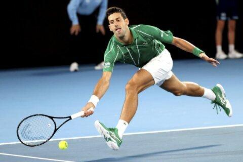 Djokovic cedes Australian Open set in 1st Rd; 1st since 2006
