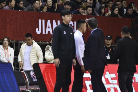 Chinese league bans basketball fan for life, suspends coach