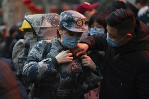 Virus death toll in China rises as US prepares evacuation