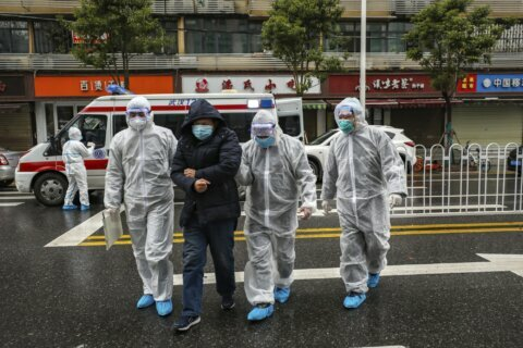 Wuhan officials face questions, anger over virus response