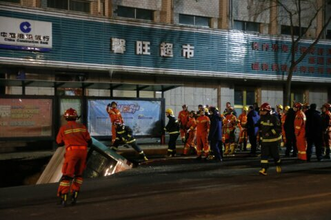 Bus falls into sinkhole on road in China; 10 dead or missing