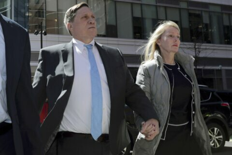 Parent faces new tax fraud charge in college bribery case