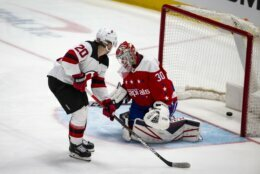 New Jersey Devils center Blake Coleman (20) scores past Washington Capitals goaltender Ilya Samsonov (30), from Russia, during the third period of an NHL hockey game, Thursday, Jan. 16, 2020, in Washington. The Capitals won 5-2. (AP Photo/Al Drago)