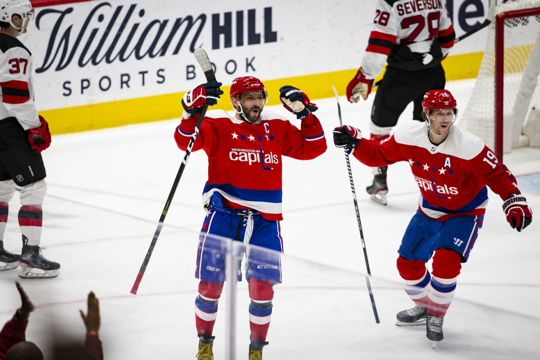 Washington Capitals left wing Alex Ovechkin (8), from Russia, celebrates with center Nicklas Backstrom (19), from Sweden, after scoring his third goal of the night for a hat trick, during the third period of an NHL hockey game against the New Jersey Devils, Thursday, Jan. 16, 2020, in Washington. The Capitals won 5-2. (AP Photo/Al Drago)