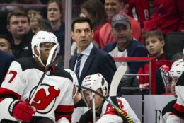 New Jersey Devils interim coach Alain Nasreddine watches during the second period of an NHL hockey game against the Washington Capitals, Thursday, Jan. 16, 2020, in Washington. (AP Photo/Al Drago)