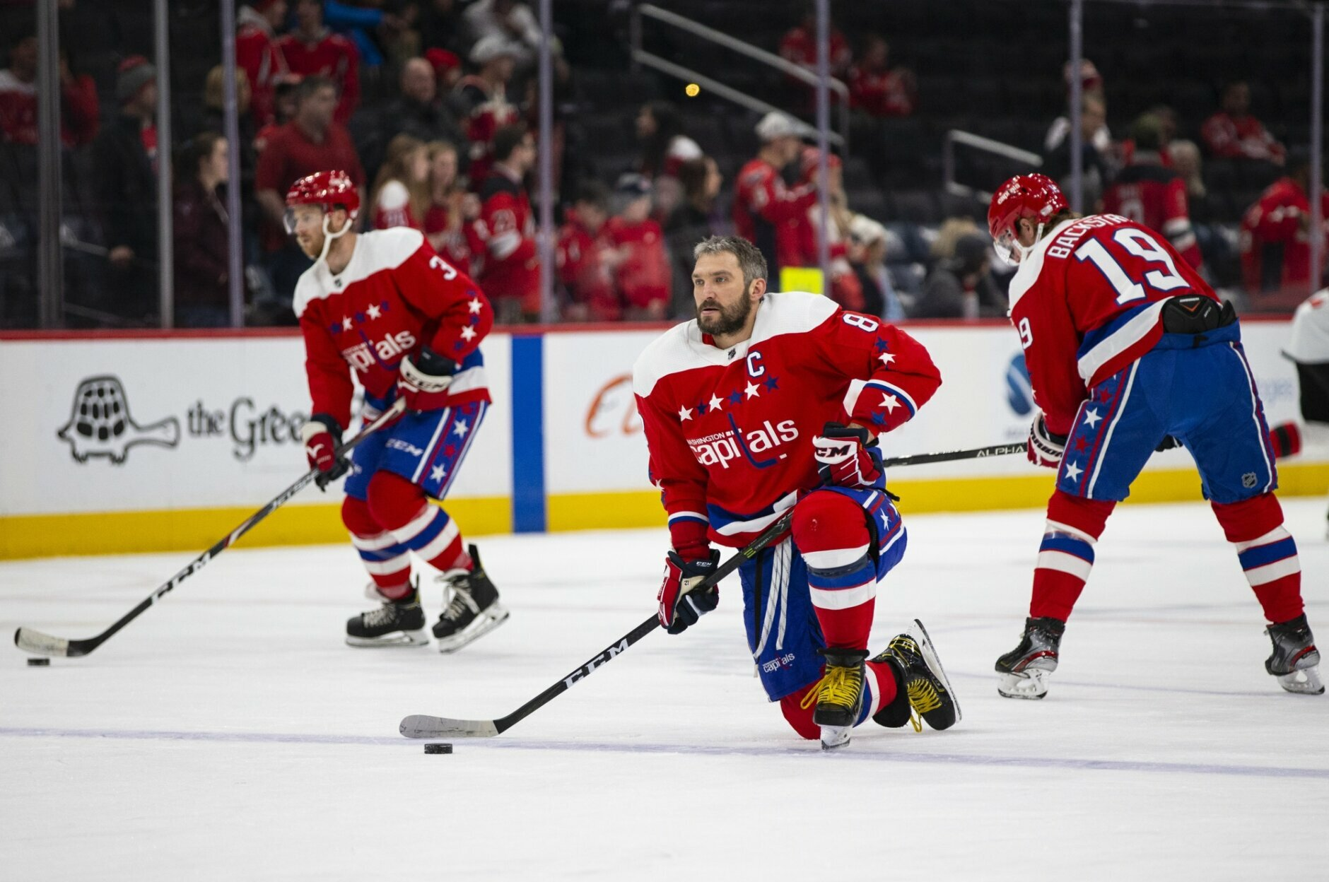 Washington Capitals left wing Alex Ovechkin (8), kneels on the ice during warmups before an NHL hockey game against the New Jersey Devils, Thursday, Jan. 16, 2020, in Washington. (AP Photo/Al Drago)