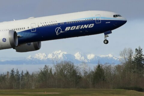 737 Max costs double, Boeing posts first loss in 2 decades