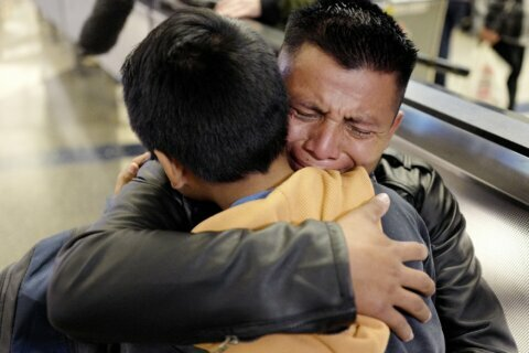 Migrant parents separated from kids since 2018 return to US