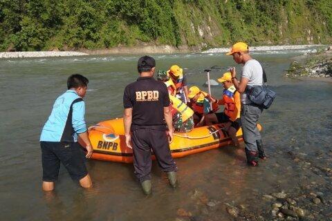 Crowded footbridge breaks over Indonesian river, killing 9