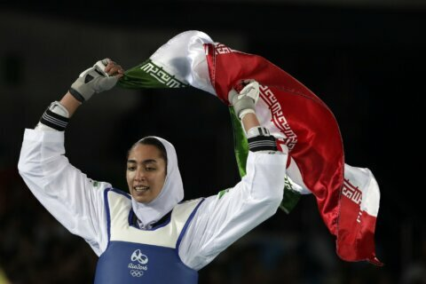 Iran's sole female Olympic medalist says she's defected