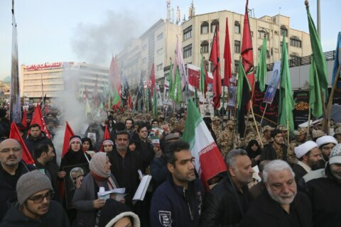 Throngs mourn, Iranian leader weeps for general slain by US