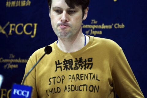 Japan convicts Australian who sought to see his children