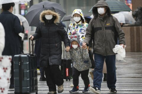 The Latest: Rise in virus cases shows it's more contagious