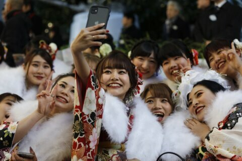 AP PHOTOS: Japan honors young adults on Coming of Age Day