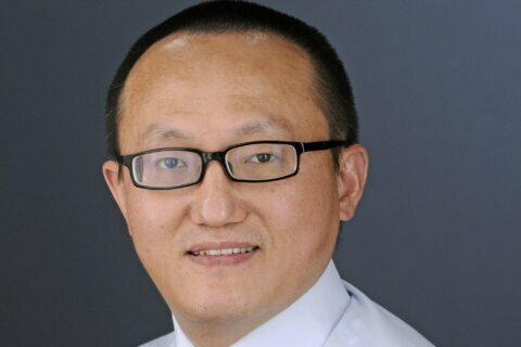 Attorney: Kansas researcher denies concealing Chinese work