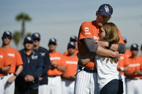 Baseball coach killed with Bryant honored at team's opener