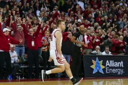 Wisconsin's Brad Davison (34) reacts after hitting the game-winning 3-point basket against Maryland in the final seconds of an NCAA college basketball game Tuesday, Jan. 14, 2020, in Madison, Wis. Wisconsin upset Maryland 56-54. (AP Photo/Andy Manis)