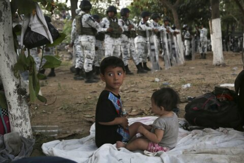 Mexico begins flying, busing migrants back to Honduras