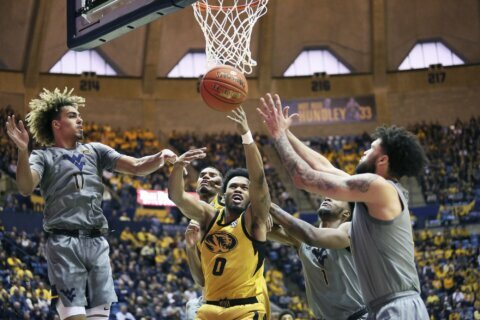 No. 14 WVU beats Missouri 74-51 in Big 12/SEC Challenge