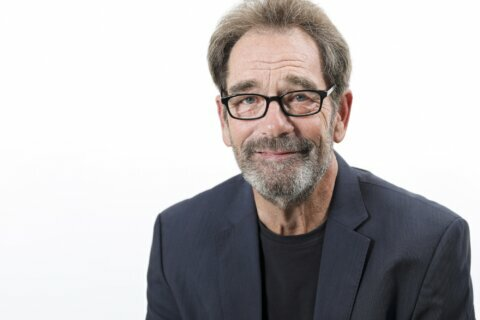 Huey Lewis pushes past hearing pain to keep making music