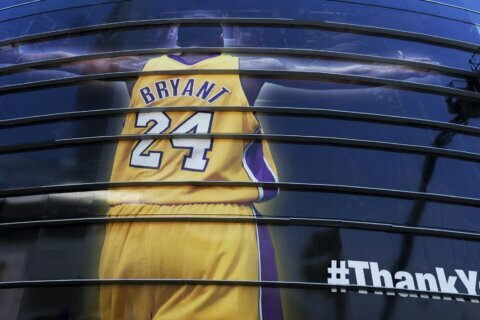 The Latest: Host Keys pays homage to Kobe Bryant at Grammys