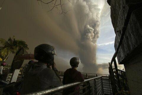 AP Photos: Ash billows from Philippine volcanic eruption