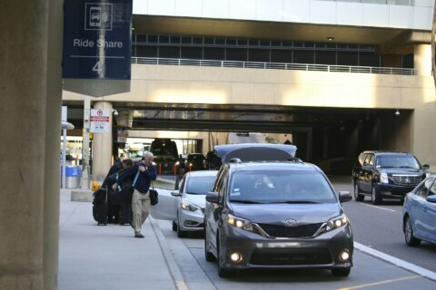 Official says Phoenix airport ride-hailing fee is illegal