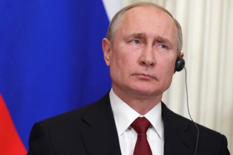 Putin engineers shake-up that could keep him in power longer