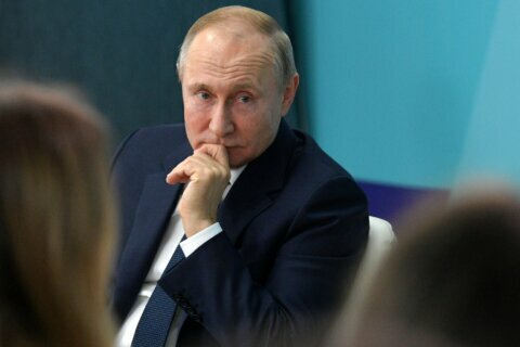 Russia's Putin remains secretive about his future role