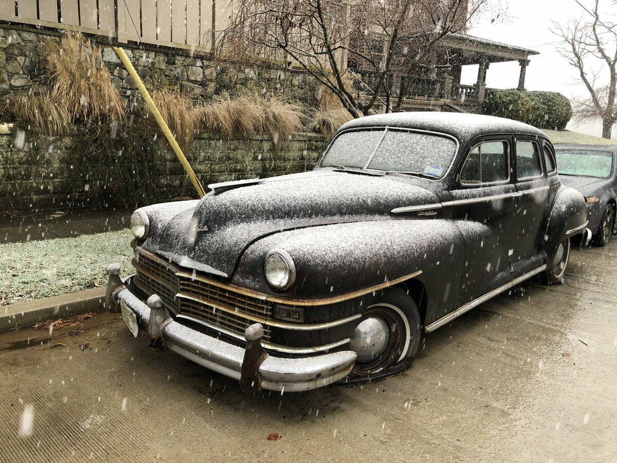 old car covered in snow