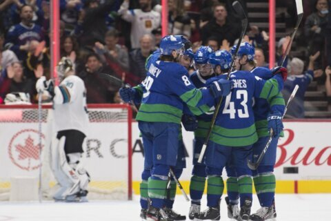 Pearson leads Canucks past Sharks and into 1st in Pacific