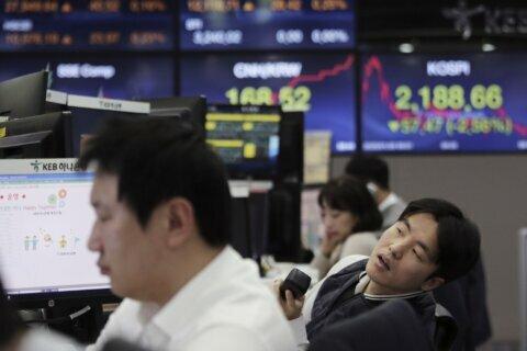 Global stocks mixed as China virus worries deepen
