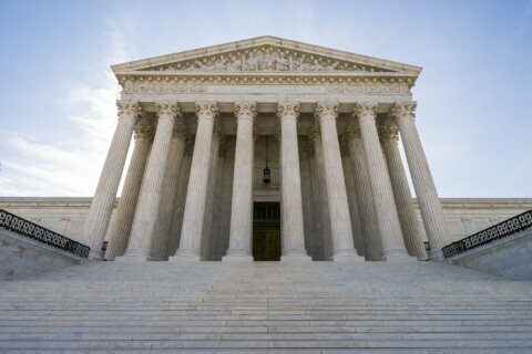 Justices allow enforcement of new green card rule