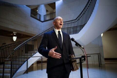 FBI says monitoring of ex-Trump aide should've ended sooner