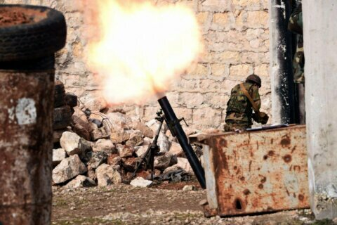 Syrian troops surround rebel-held town on 3 sides