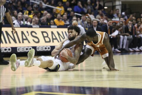 No. 14 West Virginia cruises to 97-59 win over Texas