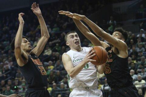 Duarte leads No. 12 Oregon past USC 79-70 in double OT