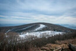 View of Wintergreen mountain on the Blue Ridge. Winter, the slopes are slightly cover with snow.
