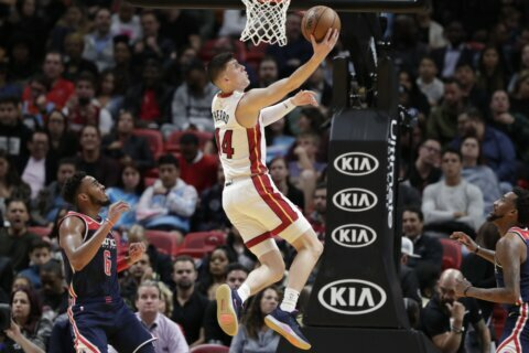 Heat waste lead, then rally to beat Wizards 134-129 in OT