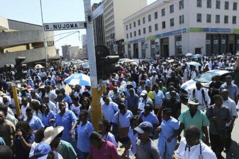 Billionaire's cash helps Zimbabwe's doctors back from strike