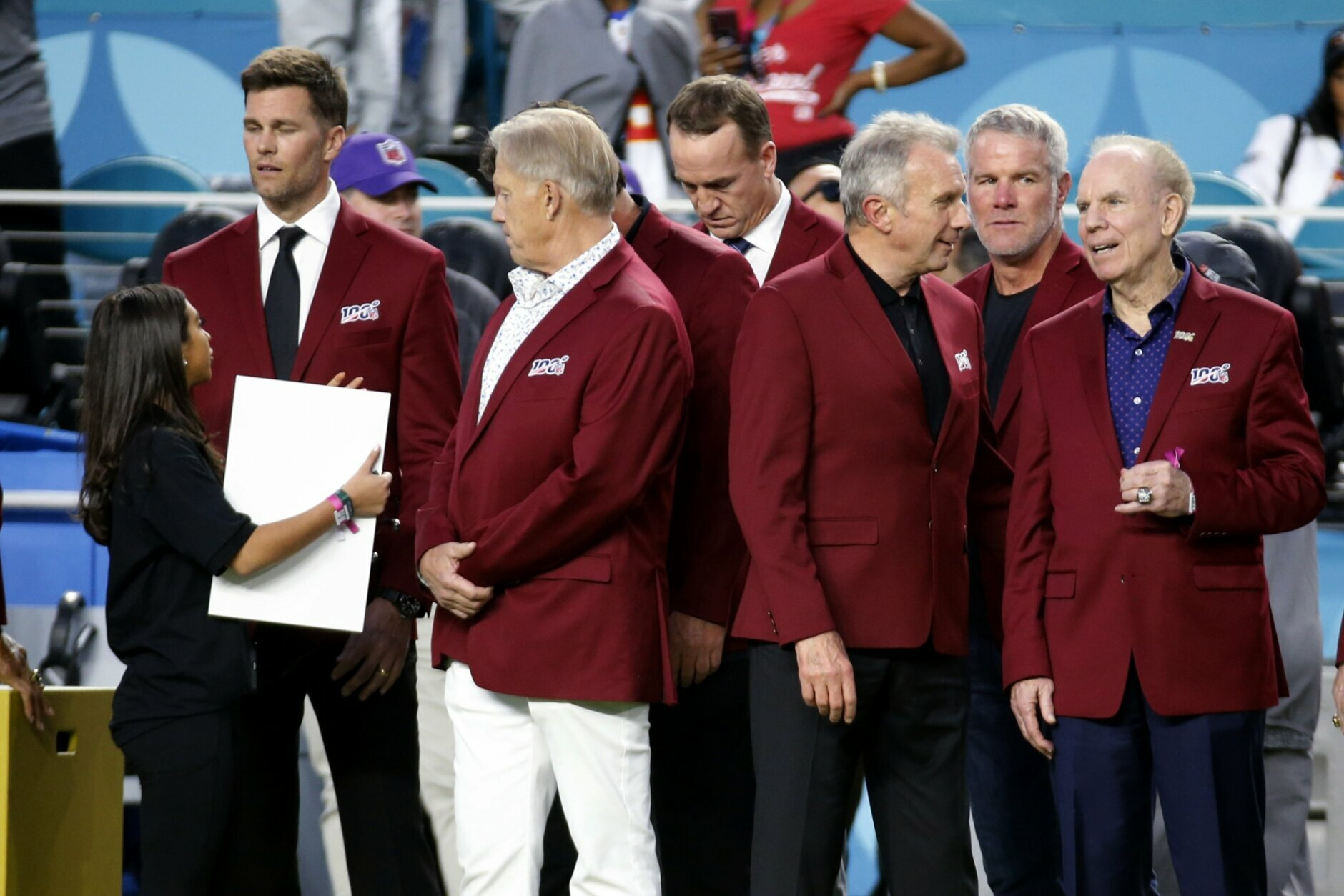 Tom Brady, John Elway, stands with Peyton Manning, Joe Montana, Brett Favre and Roger Staubach, from left, before the NFL Super Bowl 54 football game between the San Francisco 49ers and Kansas City Chiefs Sunday, Feb. 2, 2020, in Miami Gardens, Fla. (AP Photo/Mark Humphrey)